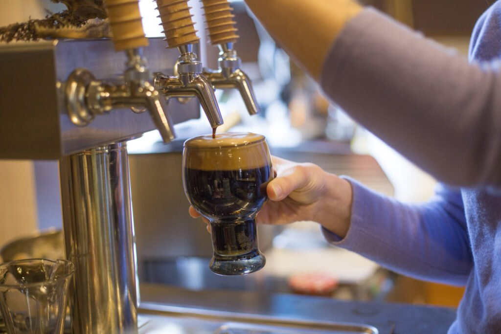 Nikaline Iacono pours a pint of Moderation Brewery's Large Marge Stout.