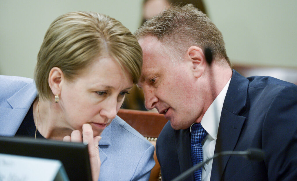 Rep. Craig Hall, R-West Valley City, confers with Rep. Karianne Lisonbee, who chairs the House Judiciary Committee, in Salt Lake City on Tuesday. Hall watched lawmakers dismantle his bill to end conversion therapy and replace it with an alternative that he says would do nothing to stop the widely discredited practice.