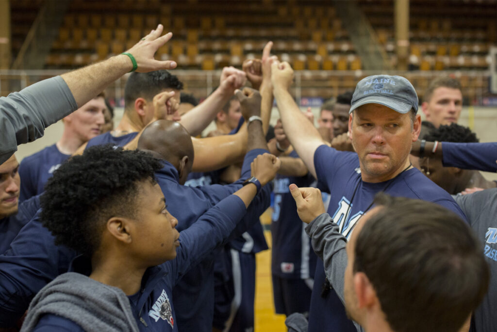 First-year UMaine men's basketball coach Richard Barron, right, thinks his team is heading in the right direction despite winning just five games this season.