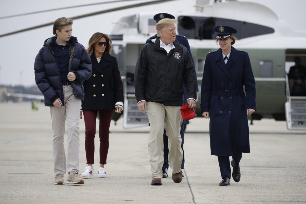 President Trump, first lady Melania Trump and their son Barron walk to board Air Force One on Friday at Andrews Air Force Base, Md. They were en route to Lee County, Ala., where tornadoes killed 23 people and caused widespread damage last Sunday.