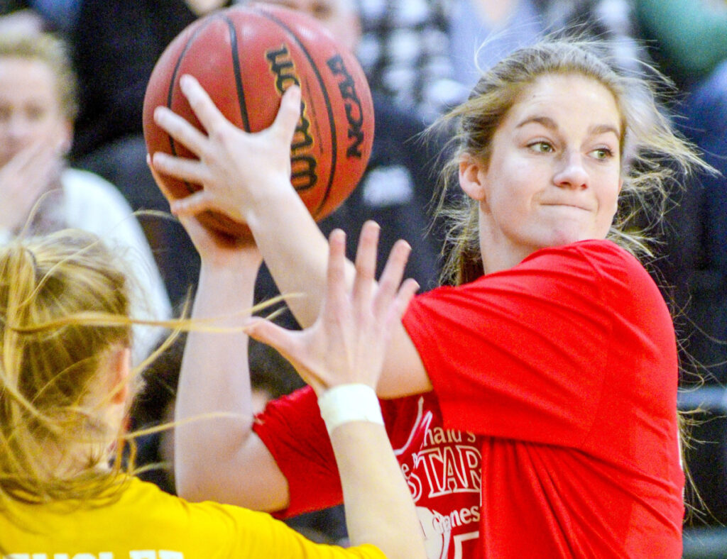 Sydney Ames of Skowhegan is defended by Greely's Anna DeWolfe during the Class AA/A/B girls' McDonald's All-Star Game on Saturday at Husson University.