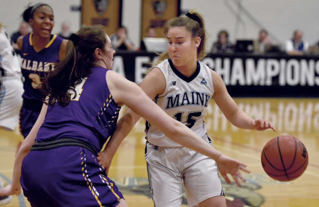 UMaine's Dor Saar is pressured by Albany's Alexi Schecter during their America East semifinal game on Sunday in Orono. The Black Bears won 66-51 to advance to the tournament championship game.