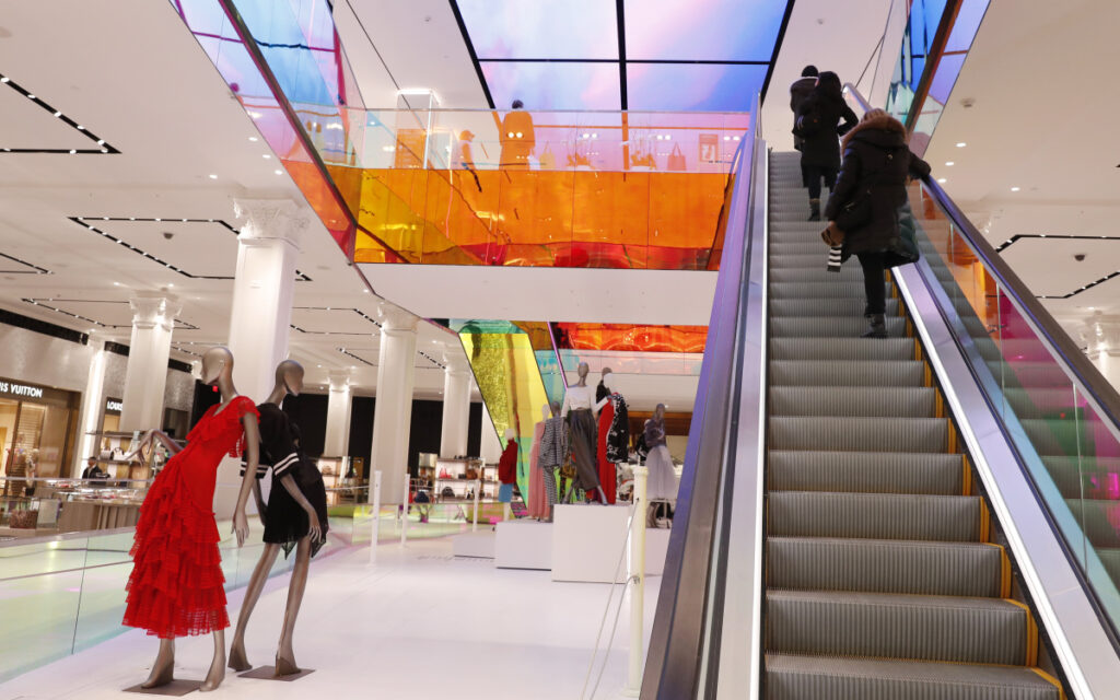 Shoppers ride the escalator at Saks Fifth Avenue's flagship midtown Manhattan store in New York last month. Economists believe growth could fall to a 1 percent annual rate or below in the first three months of this year.