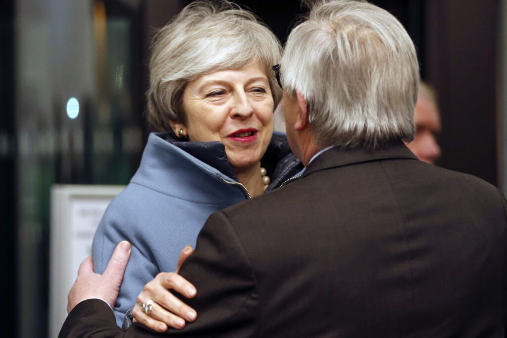 British Prime Minister Theresa May is welcomed by European Commission President Jean-Claude Juncker in Strasbourg, France, on Monday. May flew to Strasbourg to try to secure a last-minute Brexit deal with the bloc.