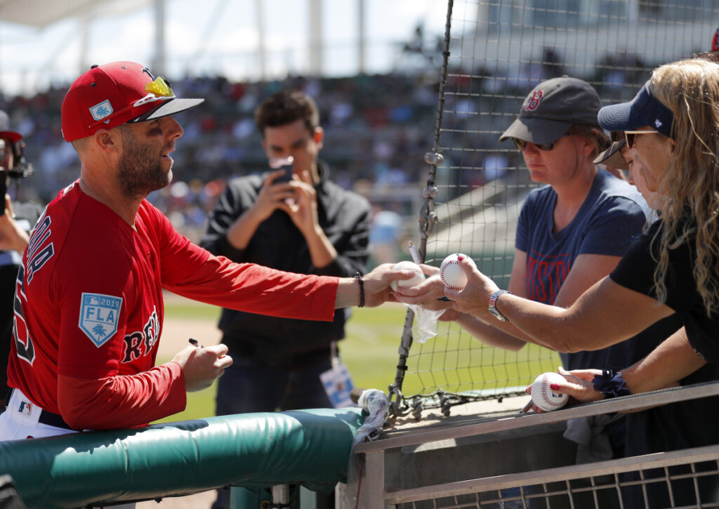 Red Sox fans have welcomed back second baseman Dustin Pedroia, seeking out autographs and giving him a standing ovation in his first at-bat of spring training. Pedroia played just three games last season after knee surgery.