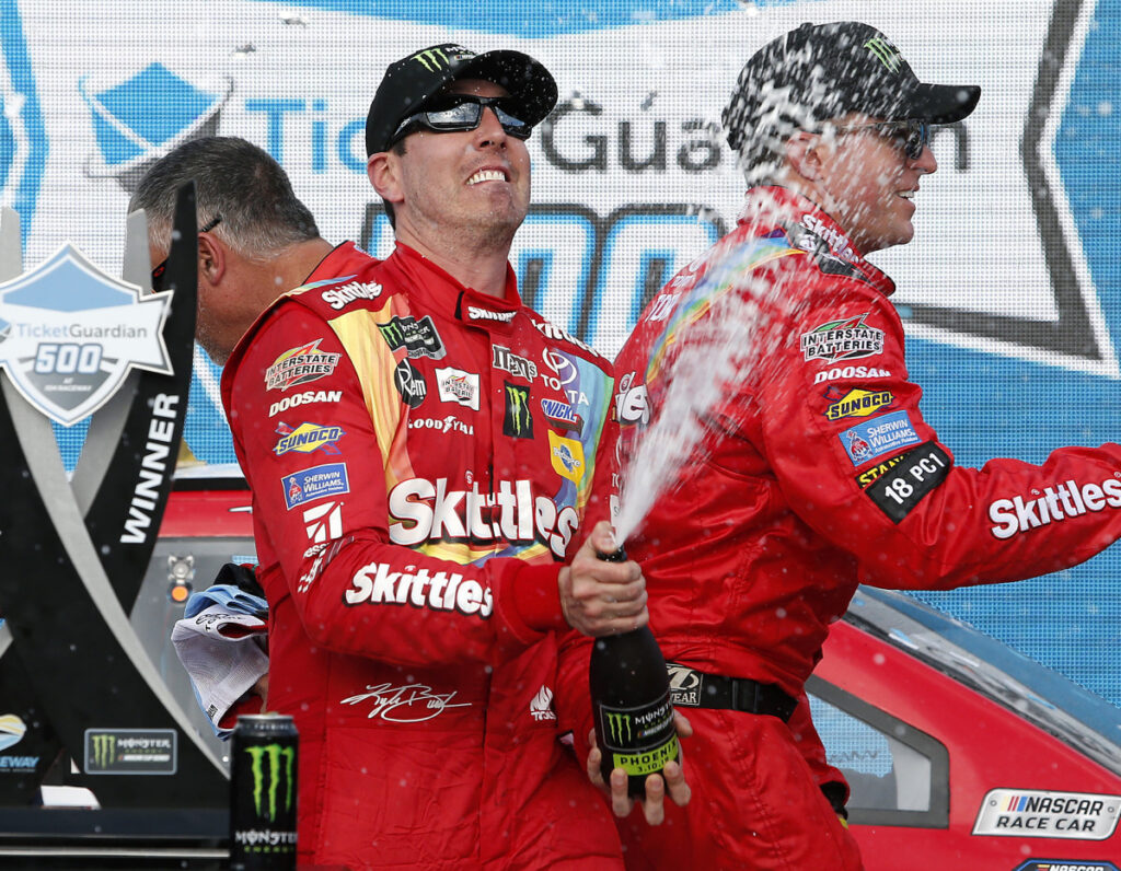 Now this is a common sight, Kyle Busch spraying champagne after a victory. He has 199 in his career, and counting.