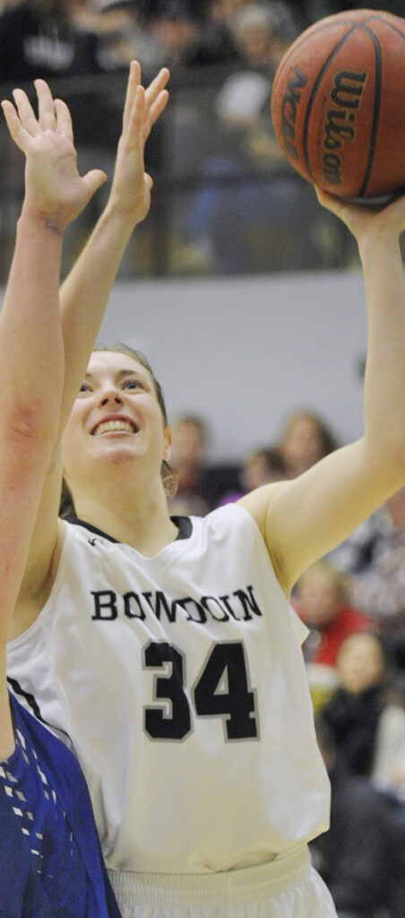 BRUNSWICK, ME -DECEMBER 2: Bowdoin College vs. Colby College women basketball game. Bangor native Cordelia Stewart scores on a short shot over Colby's #30, Emily Davis. (Photo by John Ewing/Staff Photographer)