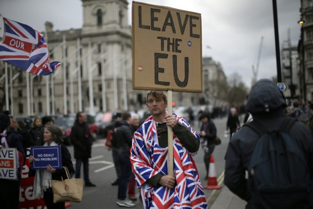 Pro-Brexit supporters make their feelings known outside Parliament on Wednesday. Inside, lawmakers voted to block the country from leaving the EU without a deal.