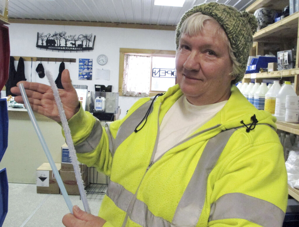 Ruth Goodrich of Goodrich's Maple Farm in Danville, Vt., holds squirrel-damaged maple sap tubing, right, and new tubing, left, in the farm's equipment shop. An abundant squirrel population is wreaking havoc on some maple operations in the Northeast as the season gets off to a late start.