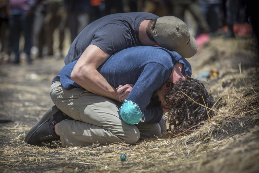 Grieving relatives break down while visiting the crash site of the Ethiopian Airlines Boeing 737 Max 8 that went down on Sunday, killing all 157 on board south of Addis Ababa.