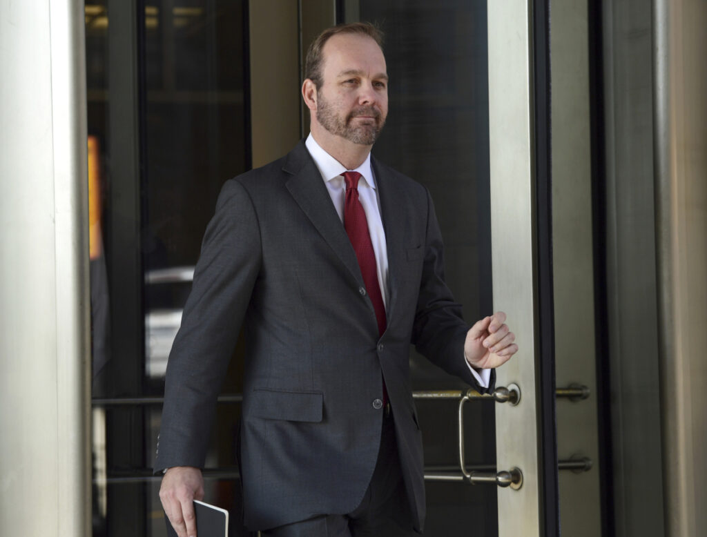 "Former Trump campaign aide Rick Gates departs federal court in Washington in December 2017. Gates is not ready to be sentenced because he continues to help with ""several ongoing investigations,"" prosecutors said in a court filing Friday."