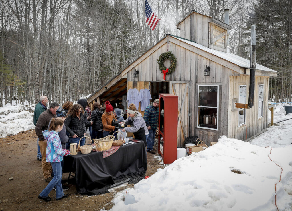Visitors tour the sugar shack and buy maple products at Hidden Roots Maple Farm in Limington as part of last year's Maine Maple Sunday.