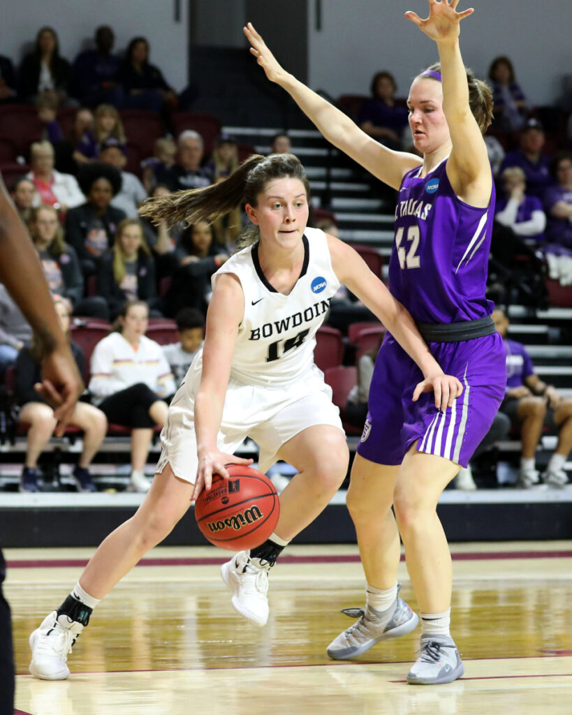 Bowdoin's Maddie Hasson drives to the basket against Hannah Spaulding of St. Thomas. Hasson led the Polar Bears with 25 points.