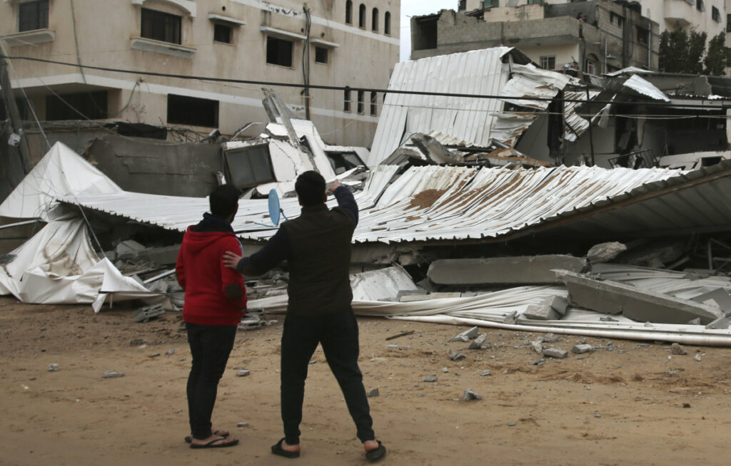 Palestinians inspect the damage to the Hamas ministry of prisoners, which was hit by Israeli airstrikes early Friday in Gaza City. Israeli warplanes attacked militant targets in the southern Gaza Strip in response to a rare rocket attack on the Israeli city of Tel Aviv, as the sides appeared to be hurtling toward a new round of violence.