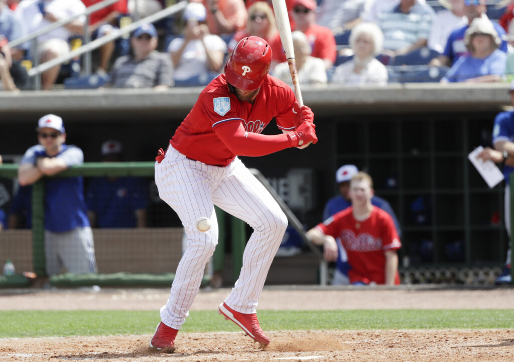 Bryce Harper of the Phillies gets hit on the right foot by a pitch, forcing him to leave Friday's exhibition against Toronto. Initial X-rays were negative.