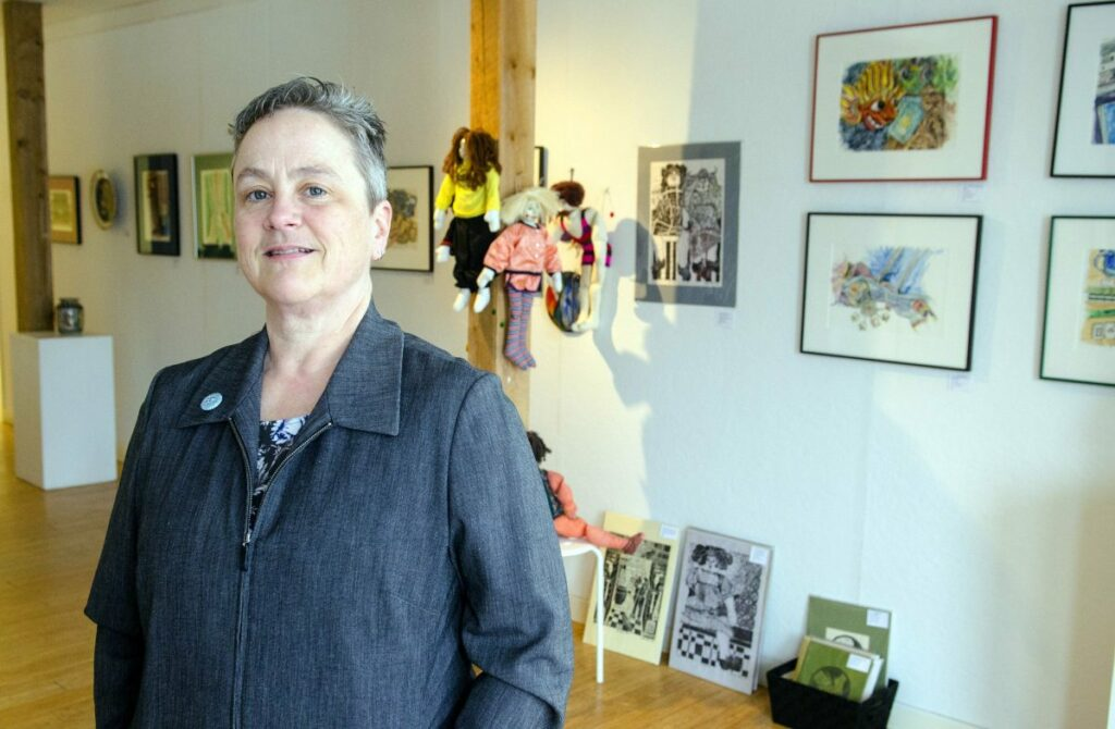 Kennebec Journal photo by Joe Phelan Executive director Deb Fahy, who is stepping down as longtime executive director of the Harlow Gallery, is seen Friday at the Water Street gallery in Hallowell.