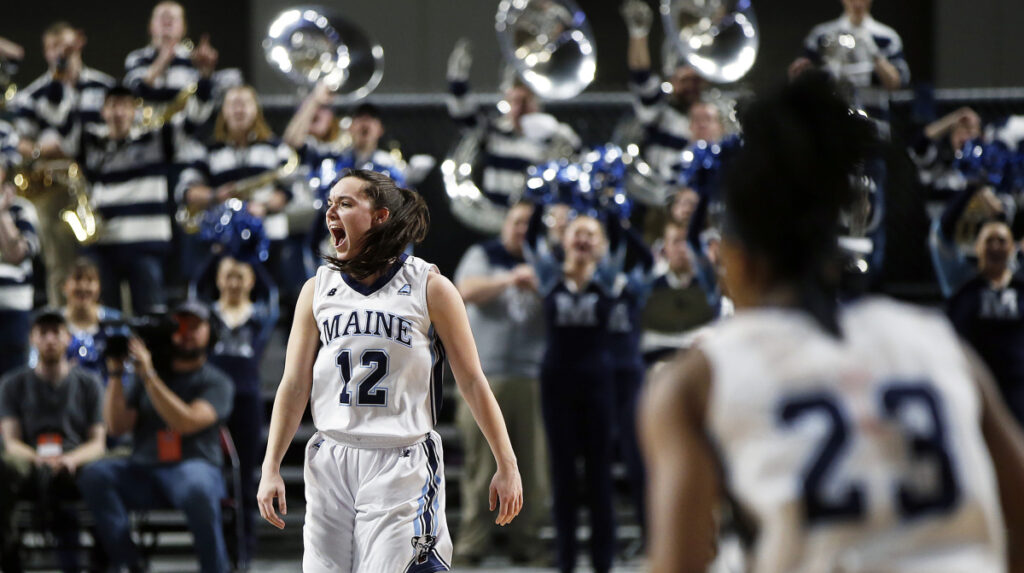 """The energy (the fans) bring is a game-changer,"" said University of Maine senior guard Parise Rossignol, left, of Van Buren. The Black Bears learn their next opponent on the NCAA's Selection Show on Monday. Ben McCanna/Staff Photographer"