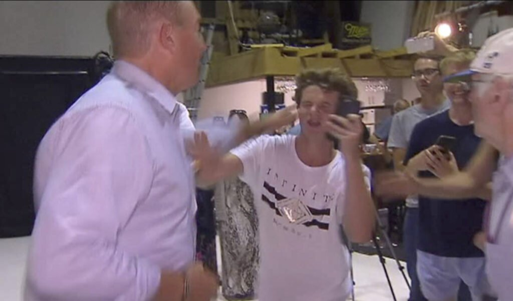 Australian Sen. Fraser Anning punches a teenager who broke an egg on his head while he was holding a news conference. Anning lunged for the 17-year-old again before the two were separated.