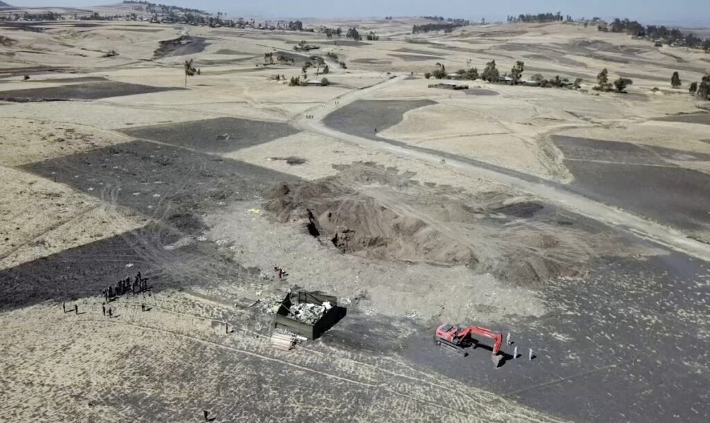This aerial image shows recovery work continuing at the scene where the Ethiopian Airlines Boeing 737 Max 8 crashed shortly after takeoff on Sunday killing all 157 on board, near Bishoftu, Ethiopia on Friday. Analysis of the flight recorders has begun in France, the airline said Friday, while in Ethiopia officials started taking DNA samples from victims' family members to identify remains.