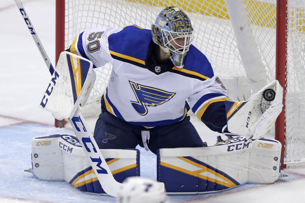 St. Louis Blues goaltender Jordan Binnington gloves a shot during the first period of Saturday's game in Pittsburgh.