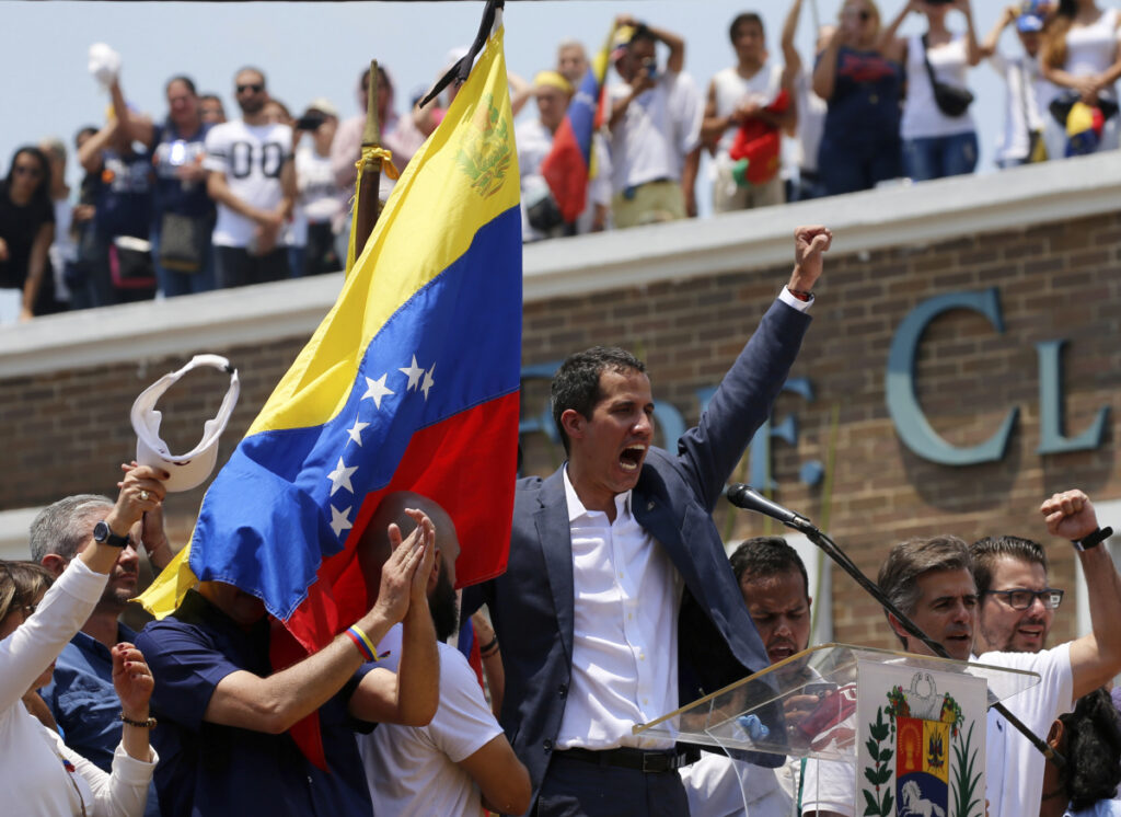 Venezuela's opposition leader and self-proclaimed interim president Juan Guaido sings the national anthem at the end of a rally in Valencia, Venezuela, on Saturday.