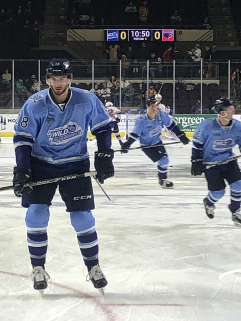 Ryan Ferrill, left, warms up with teammates before the March 9 game in Portland between the Maine Wild Blueberries and the visiting South Carolina Stingrays. It was the second-biggest night for merchandise sales for the Maine Mariners this season.