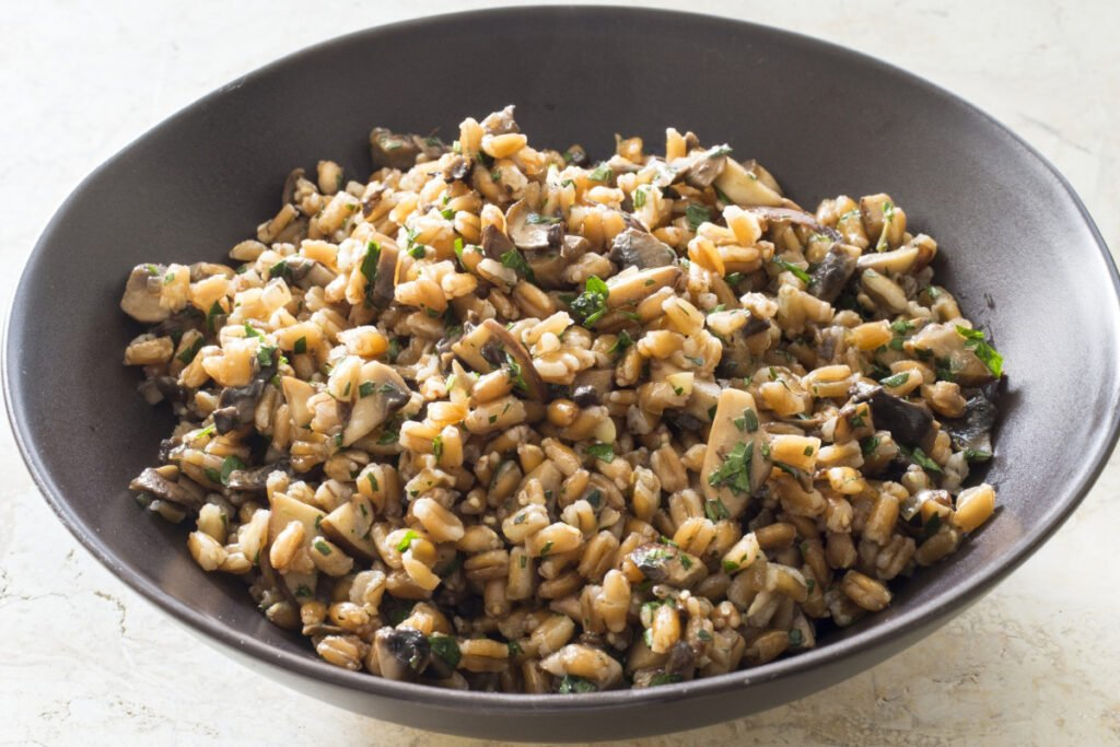 "Warm farro with mushrooms is one of those dishes you simply look at and you can hear your tummy pleading, ""Yes, yes, yes."" Only takes an hour to prepare and as for the diet, not bad. Not bad at all."