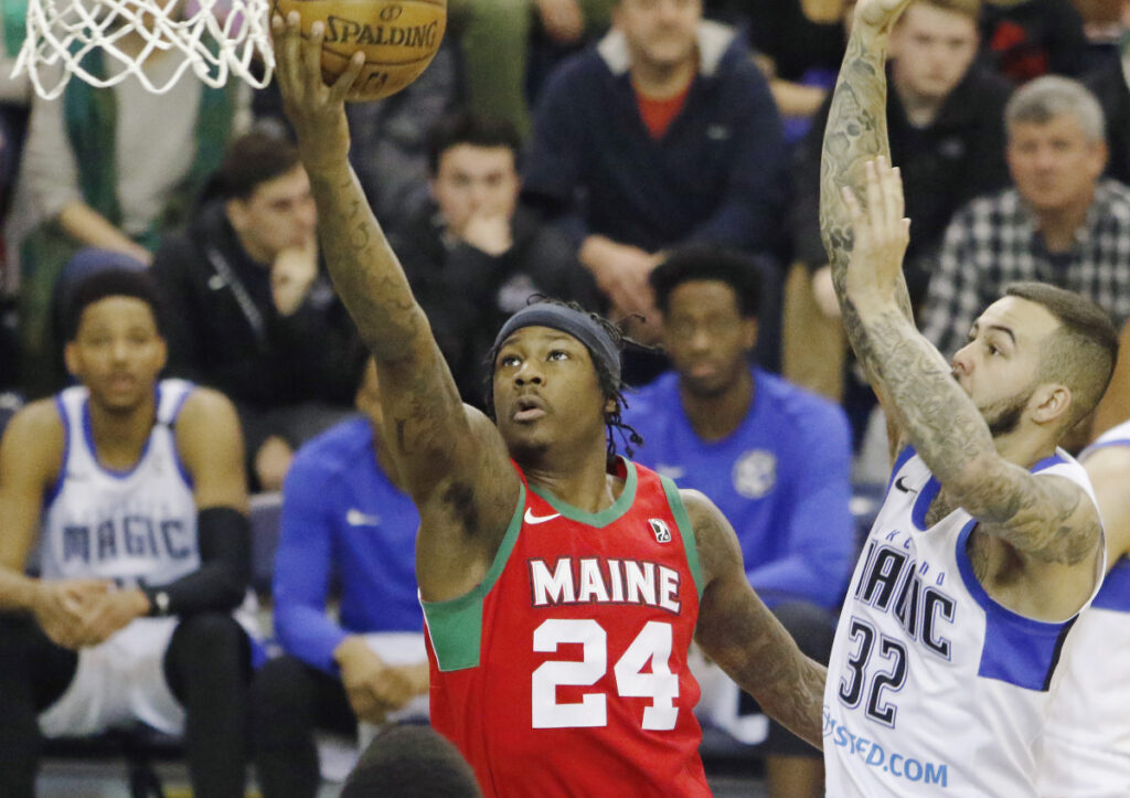 Archie Goodwin of the Maine Red Claws goes up for a shot Sunday past Gabe York of the Lakeland Magic in the first half of Lakeland's 112-103 win at the Portland Expo. The Claws, who are 19-28, will have three road games to end the season.