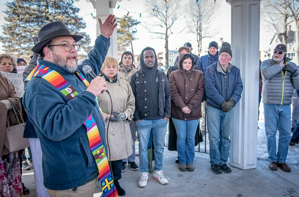 Andree Kehn/Sun Journal The Rev. Stephen Carnahan was one of many religious leaders to open Sunday's vigil in Lewiston's Kennedy Park. (Sun Journal photo by Andree Kehn)