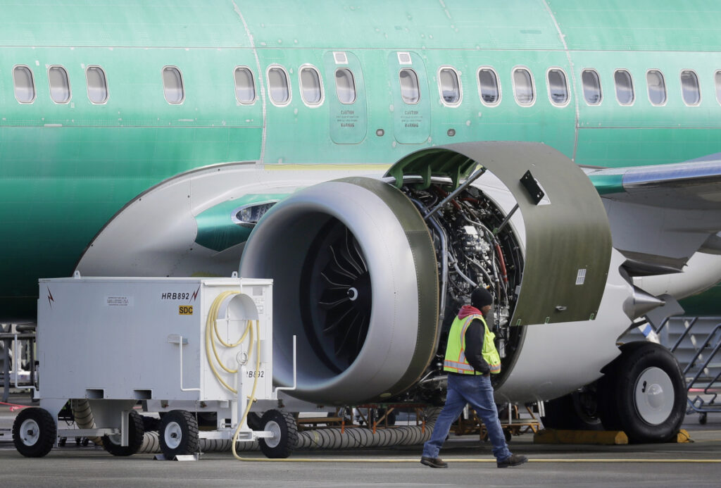 A worker walks past an engine on a Boeing 737 MAX 8 airplane being built for American Airlines at Boeing Co.'s assembly plant in Renton, Wash., last week.