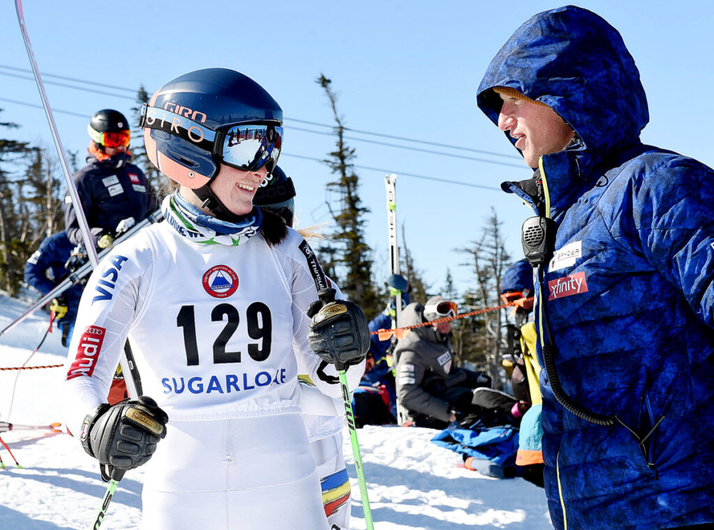 Ella Spear, left, talks with Brad Farrell, a U.S. ski team coach, before taking her first training run Monday at Sugarloaf. Spear, a native of Boothbay, will ski in a national meet.