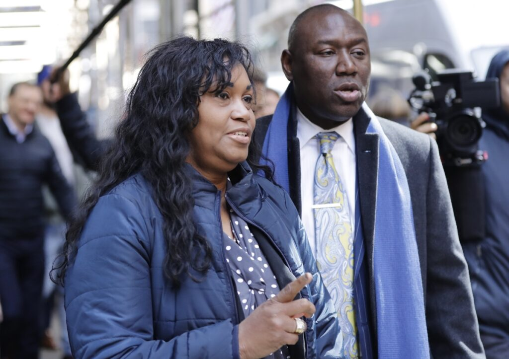 "Tamara Lanier and attorney Benjamin Crump arrive for a news conference near the Harvard Club on Wednesday in New York. Lanier is suing Harvard University for ""wrongful seizure, possession and expropriation"" of images she says depict two of her ancestors."