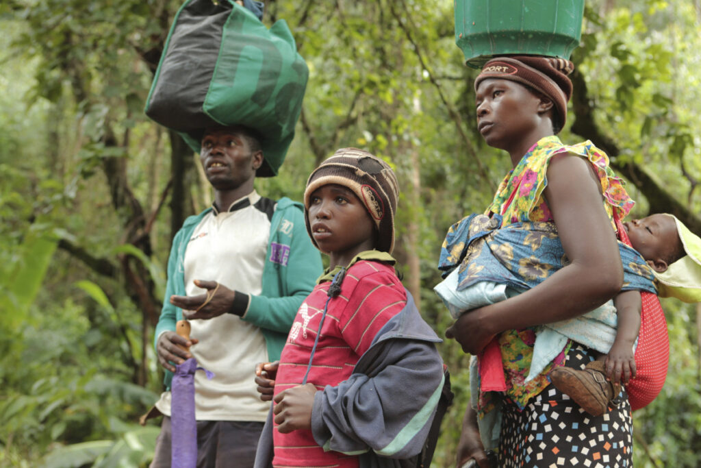 Luckymore Rusero and his family carry their belongings along a collapsing road in Chimanimani, southeast of Harare, Zimbabwe, on Monday.