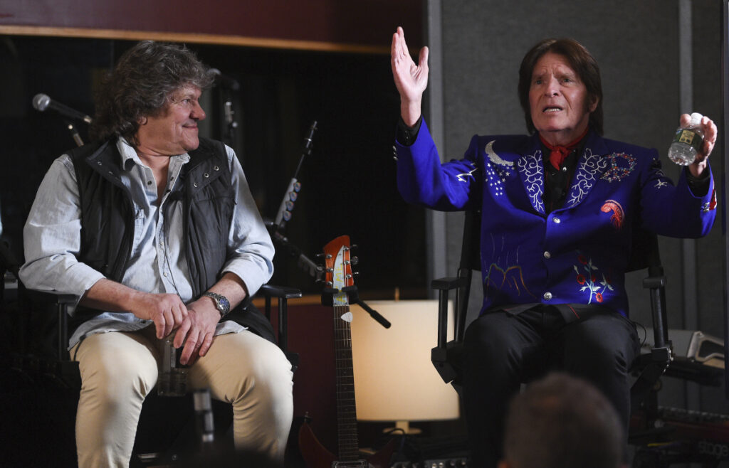 Woodstock co-founder Michael Lang, left, and musician John Fogerty discuss the lineup for the Woodstock 50 concert in August during an announcement at Electric Lady Studios in New York on Tuesday.