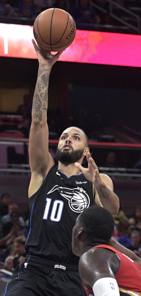 Orlando's Evan Fournier shoots over New Orleans' Cheick Diallo in the second half Wednesday night at Orlando, Fla. Fournier scored 22 points in Orlando's 119-96 win.