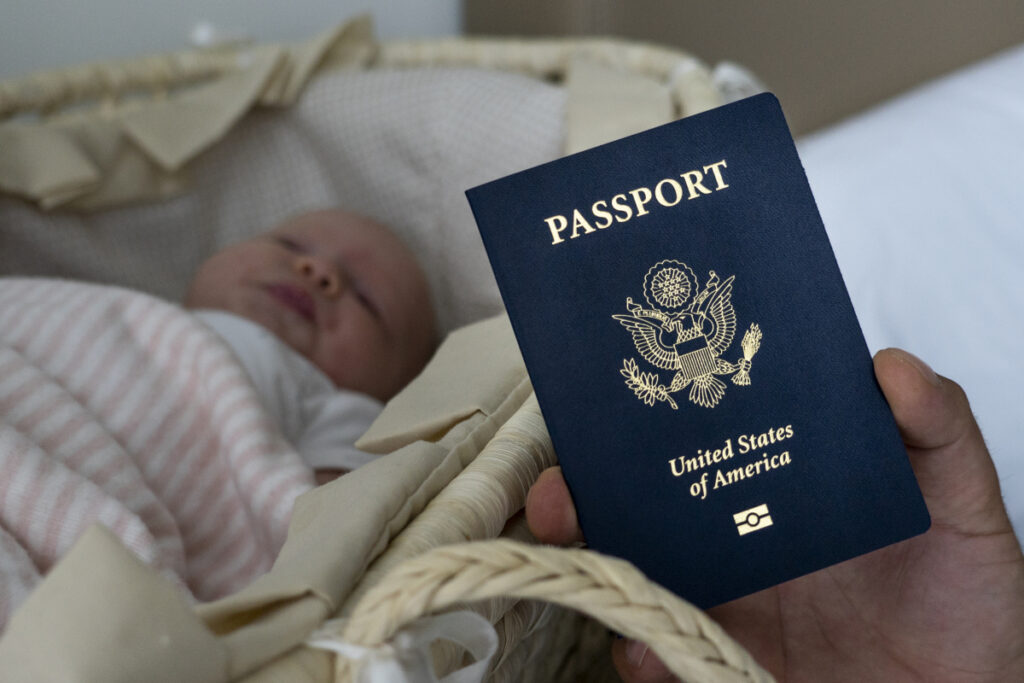 Olga Zemlyanaya's baby, Eva, with her new passport in Florida in January.