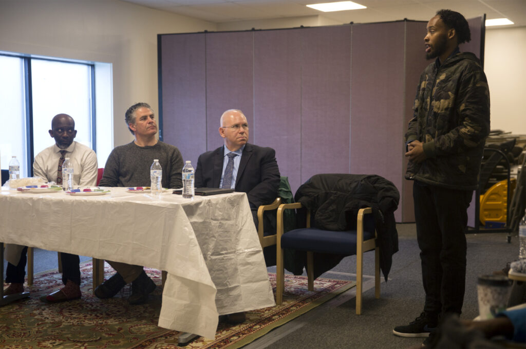 From left, City Councilor Pious Ali, Mayor Ethan Strimling and interim Police Chief Vern Malloch listen to Liban Muse, 23, speak Friday about the death of his younger brother, Isahak Muse, in a shooting on March 16.