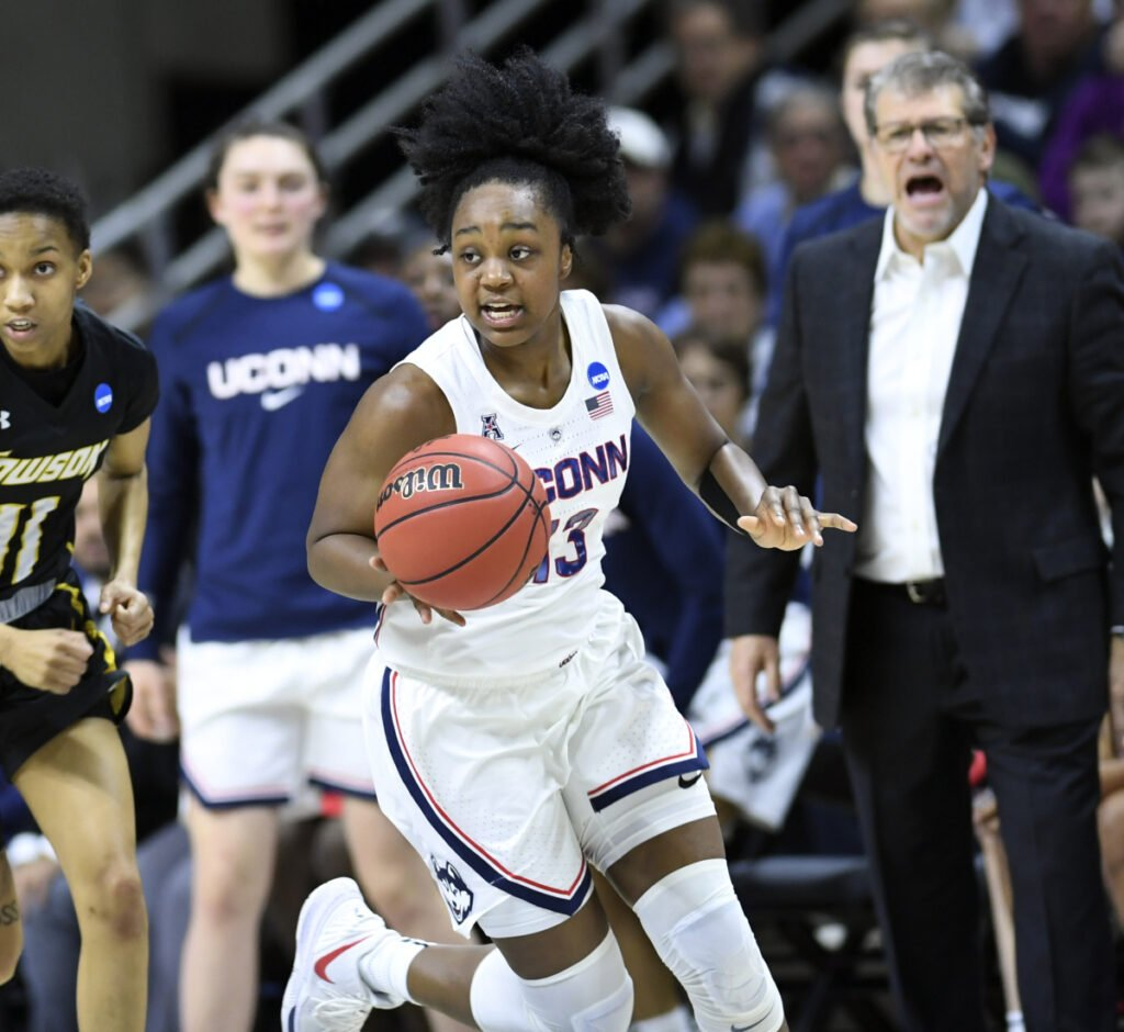 Connecticut's Christyn Williams scored 21 points Friday night, leading the Huskies to their 26th straight first-round win, 110-61 over Towson.