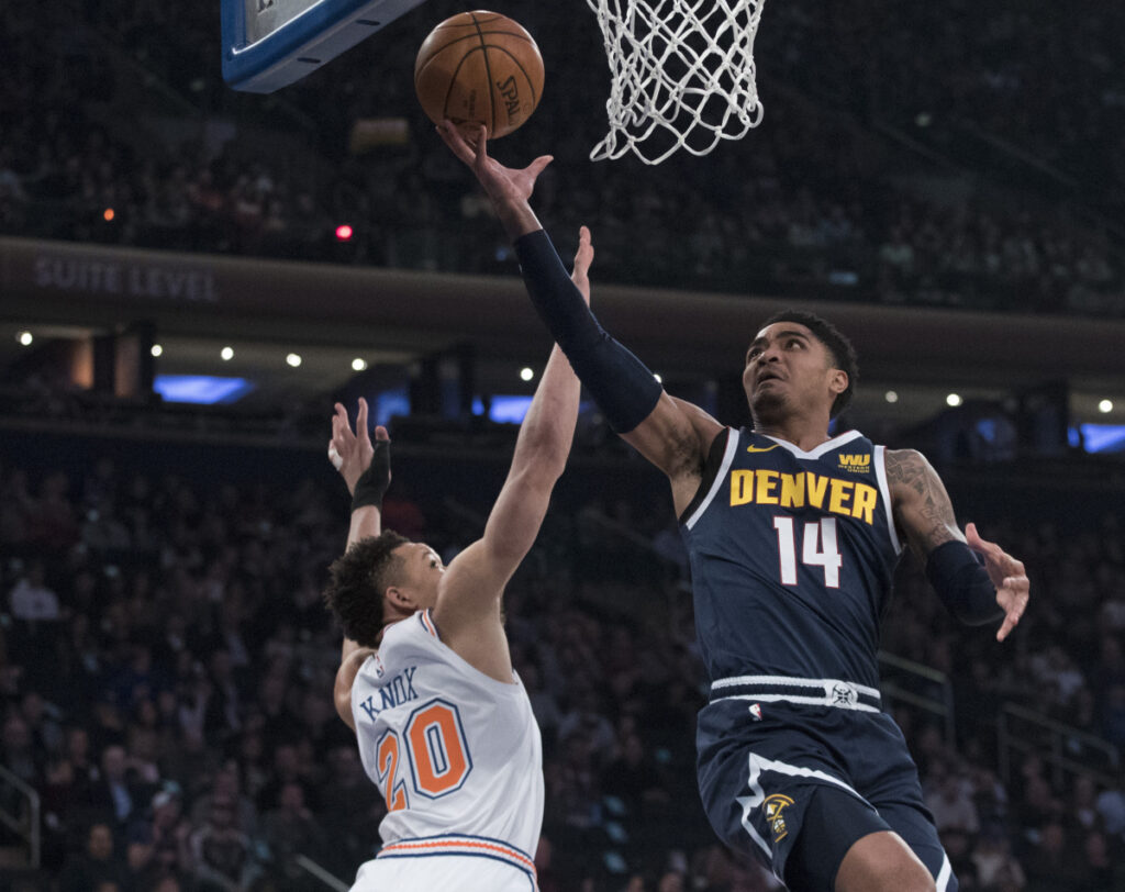 Denver's Gary Harris goes to the basket against New York's Kevin Knox in Friday night's game at New York. Denver won its sixth straight, 111-105.