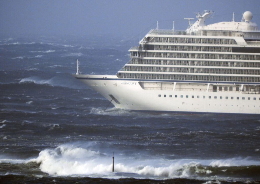 The cruise ship Viking Sky lays at anchor in heavy seas, after it sent out a mayday signal because of engine failure in windy conditions, off the coast of Norway.
