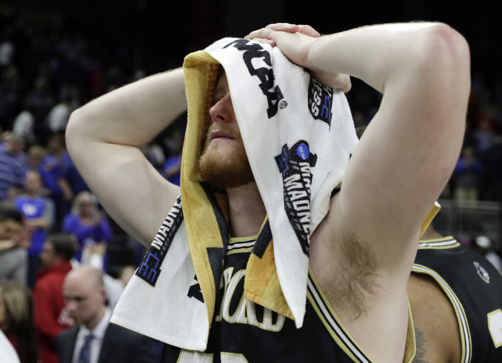 Matthew Pegram of Wofford walks off the court Saturday after his team's season ended with a 62-56 loss to Kentucky in the second round game of the NCAA tournament. Fletcher Magee, the top shooter for Wofford, went 0 of 12 from 3-point range.