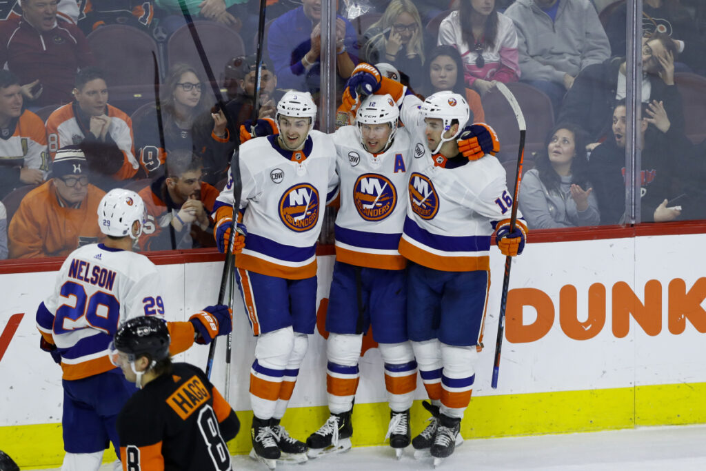 New York Islanders, from right, Andrew Ladd, Josh Bailey, Adam Pelech and Brock Nelson celebrate after Bailey's goal during Saturday game in Philadelphia. New York won 4-2.