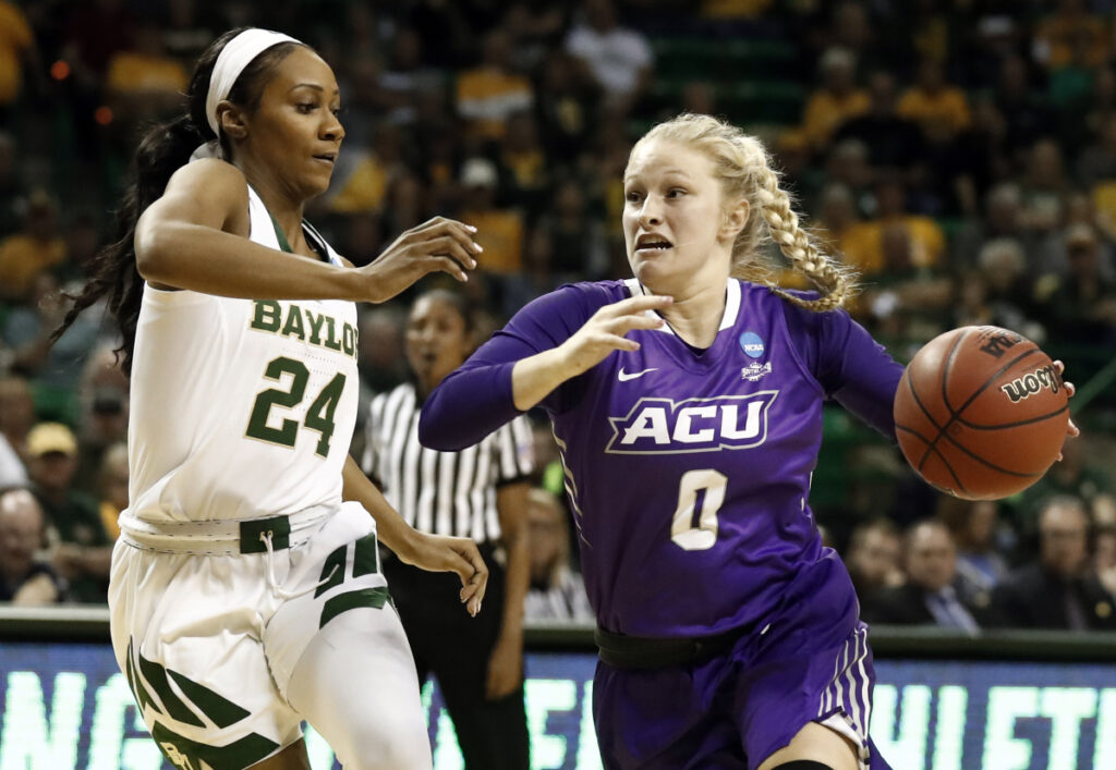 Associated Press/Tony Gutierrez   Baylor guard Chloe Jackson, left, defends against a drive to the basket by Abilene Christian 's Kamryn Mraz in Waco, Texas on Saturday.