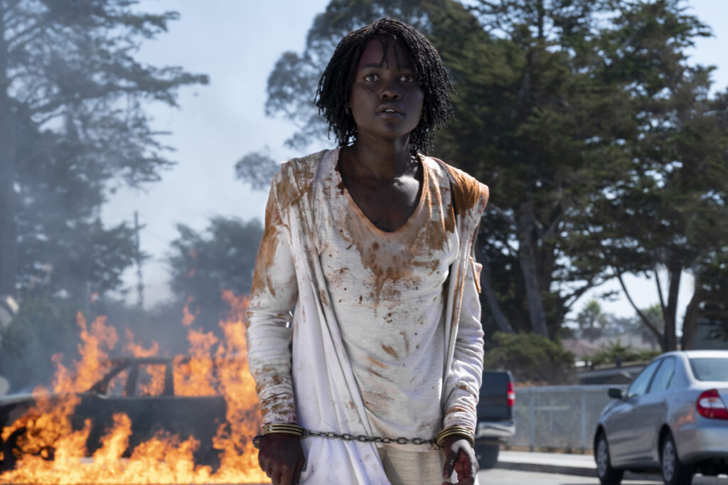 "Lupita Nyong'o stars in ""Us,"" a horror film in which a family of four is terrorized by malevolent doppelgangers."