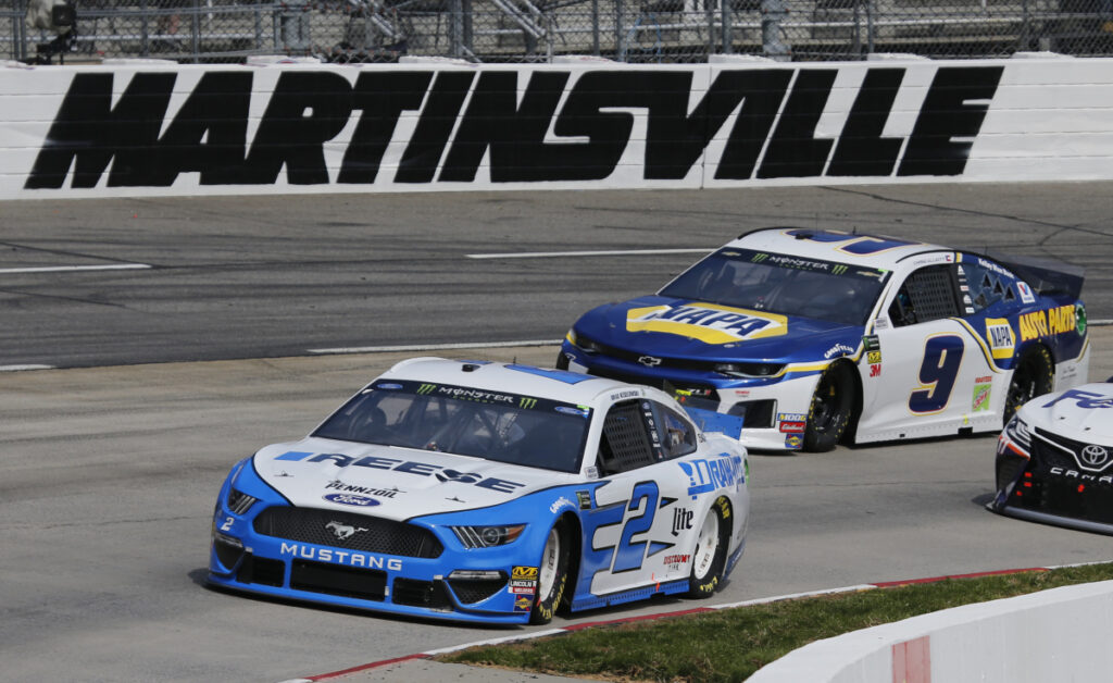 Brad Keselowski leads Chase Elliott during the NASCAR Cup Series race Sunday at Martinsville Speedway in Martinsville, Va. Keselowski led 446 laps and won the race.