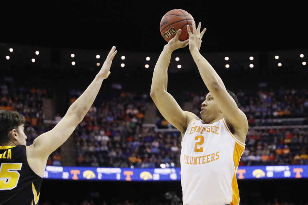 Tennessee's Grant Williams shoots over Luka Garza of Iowa during their second-round NCAA tournament game Sunday in Columbus, Ohio. Tennessee won in overtime, 83-77.