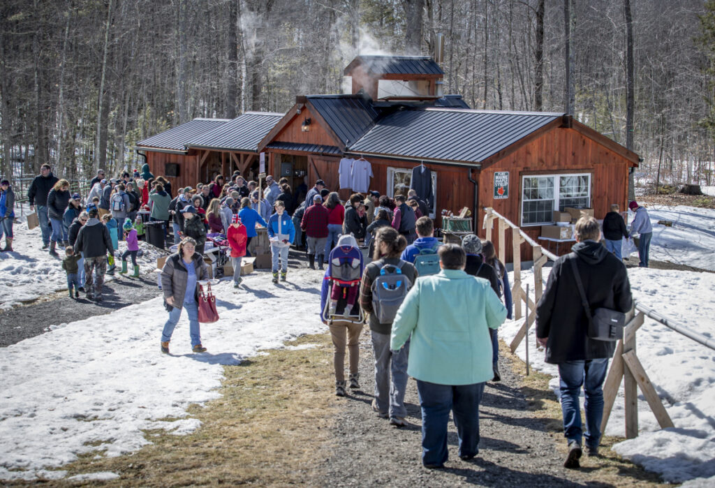 Visitors tour Dunn Family Farm in Buxton as part of Maine Maple Sunday.