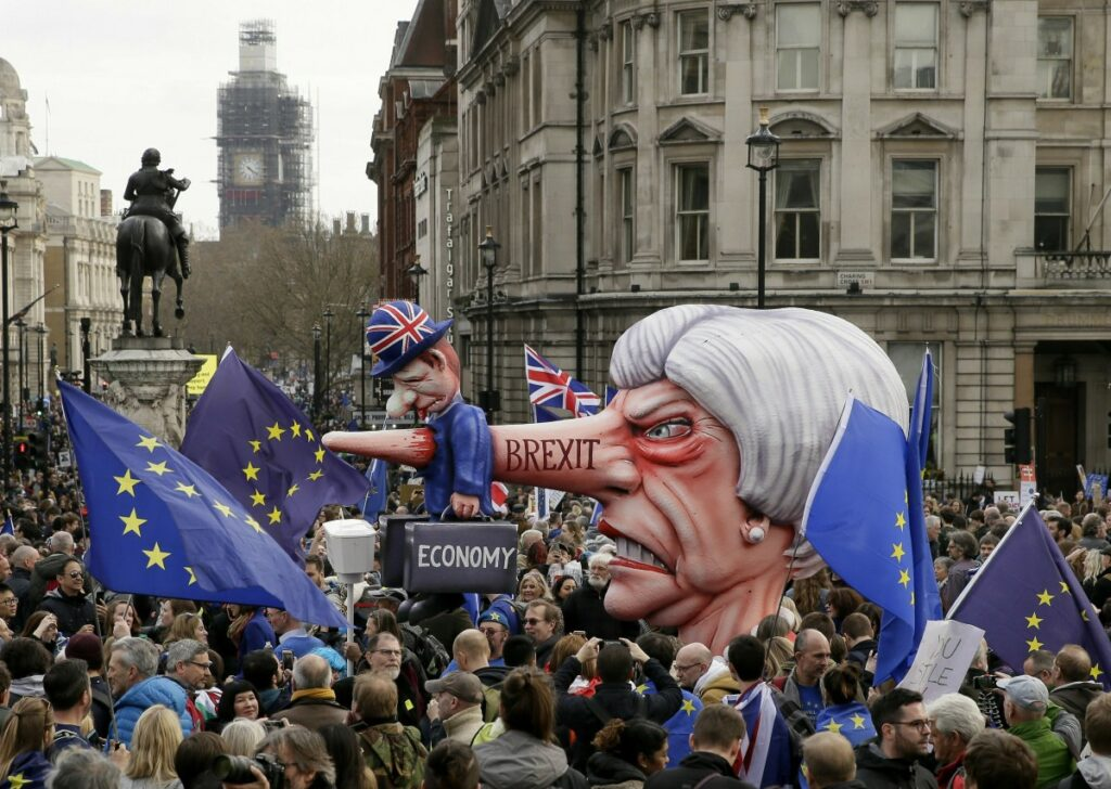 An effigy of British Prime Minister Theresa May is wheeled through Trafalgar Square during a Peoples Vote anti-Brexit march in London on Saturday.
