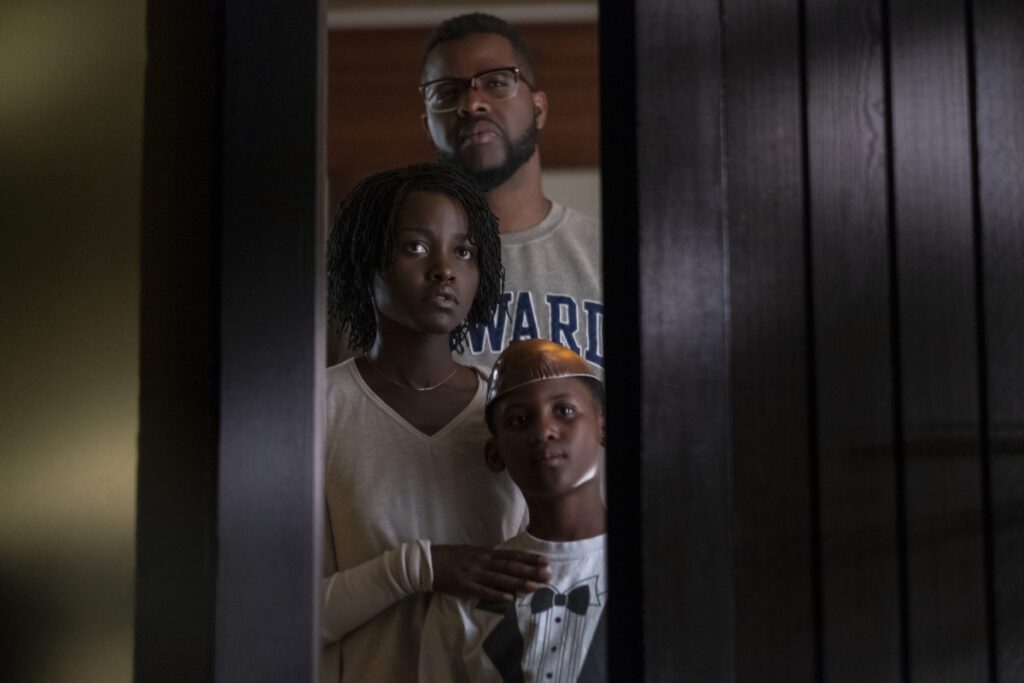 """Winston Duke, Lupita Nyong'o and Evan Alex in a scene from """"Us,"""" written, produced and directed by Jordan Peele."""