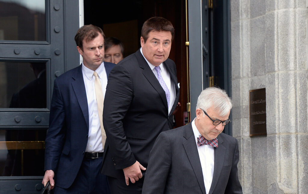 Michael Liberty, center, leaves the federal district courthouse in Portland on Thursday after pleading not guilty to defrauding investors of millions of dollars. With Liberty are his attorney's Alfred Frawley IV, left, and Thimi Mina.